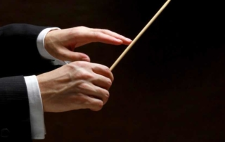 """Conductors"" in the Workplace— What We Can Learn From an Orchestra's Leadership"